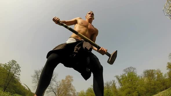 Thumbnail for Close Up Of A Strong Man Hitting With A Hammer