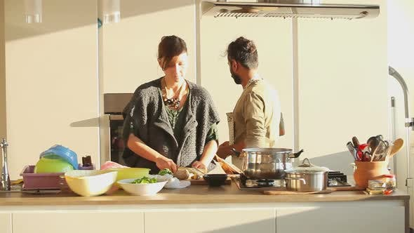 Thumbnail for Young Couple Preparing Lunch In The Kitchen 13