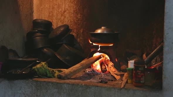 Thumbnail for View Burning Fire Heating A Pot For Cooking In Local Kitchen In Sri Lanka 1