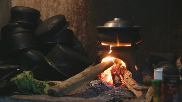Thumbnail for View Burning Fire Heating A Pot For Cooking In Local Kitchen In Sri Lanka 2