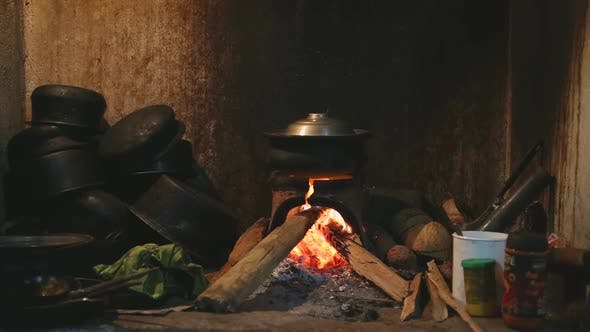 Thumbnail for View Burning Fire Heating A Pot For Cooking In Local Kitchen In Sri Lanka 3