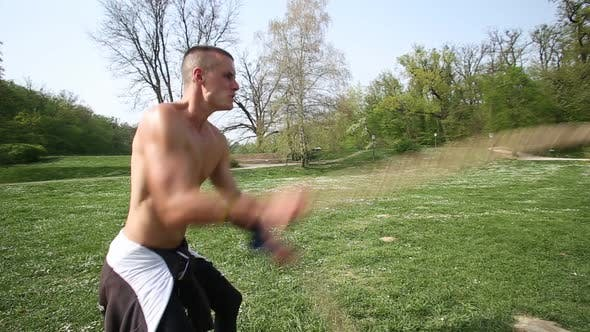 Thumbnail for Close Up Of Man Training With Ropes 1