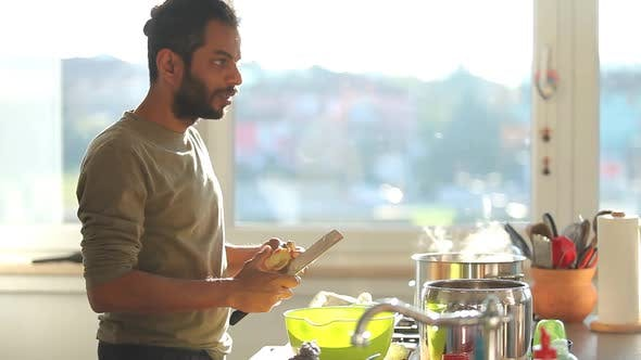 Thumbnail for Young Indian Man Preparing Lunch In The Kitchen 1