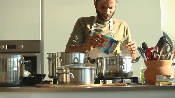 Thumbnail for Young Indian Man Preparing Lunch In The Kitchen 11