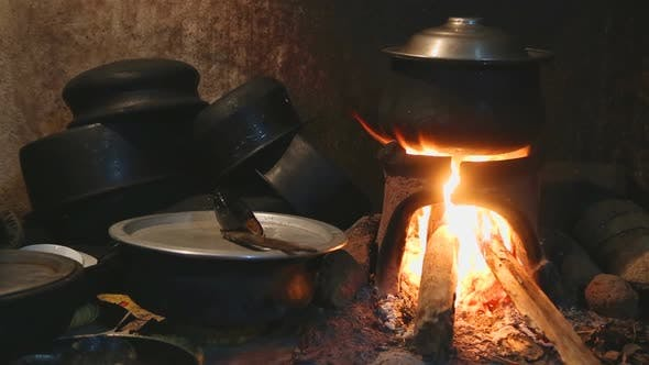 Thumbnail for View Of Burning Fire Heating A Pot For Cooking In Local Kitchen In Sri Lanka