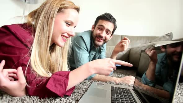 Thumbnail for Good Looking Couple Shopping Online On Laptop