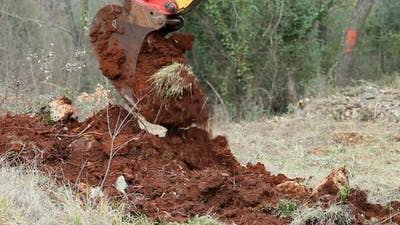 Heavy Machinery Digger Excavating Earth For Construction