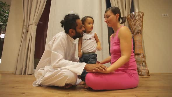 Thumbnail for Couple With Baby In Yoga Centre 1