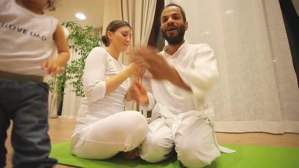 Thumbnail for Couple With Baby In Yoga Centre 3