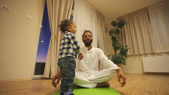 Thumbnail for Indian Man With Kid Practicing Yoga 2