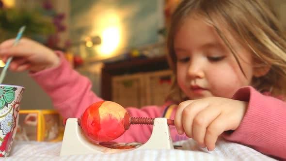 Thumbnail for Little Girl Painting Egg For The Easter Holidays