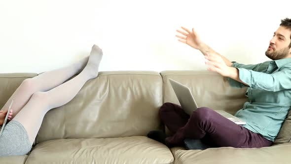 Thumbnail for Woman And Man Hanging Out On Couch In Living Room 1