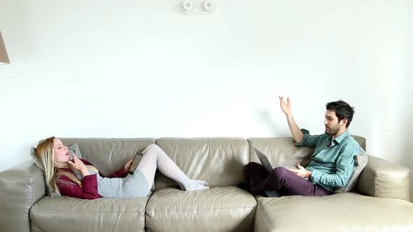 Thumbnail for Woman And Man Sitting On Couch And Relaxing 2