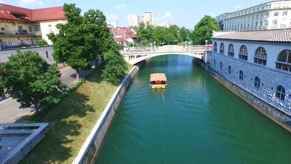 Thumbnail for Aerial View Of Bridge And Boat On The River Ljubljanica In Ljubljana, Slovenia 1