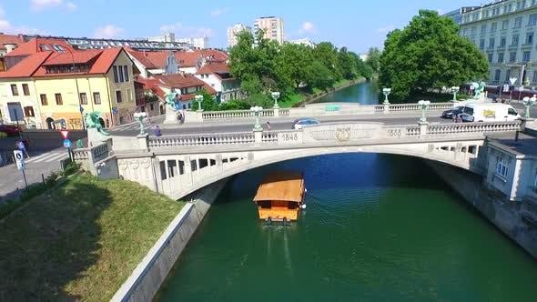 Thumbnail for Aerial View Of Bridge And Boat On The River Ljubljanica In Ljubljana, Slovenia 2
