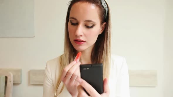 Thumbnail for Beautiful Young Woman Putting On Lipstick In A Restaurant 2