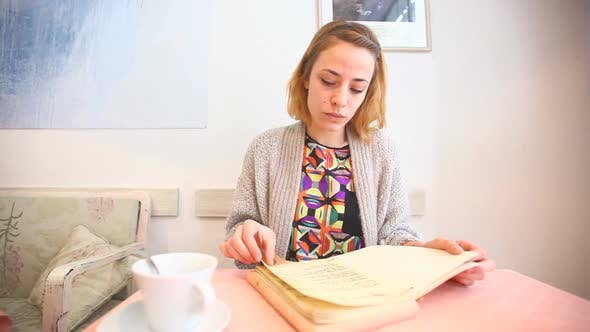 Thumbnail for Beautiful Young Woman Reading The Menu In A Cafe 2