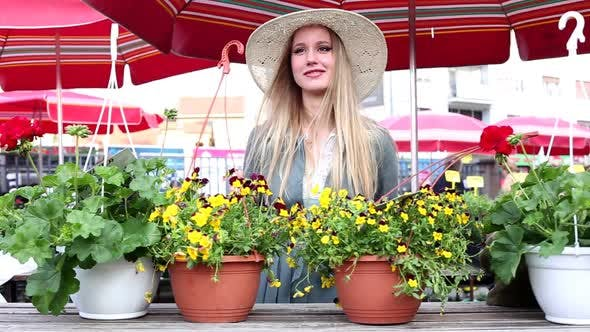 Thumbnail for Blonde Girl Standing In The Market, Smiling