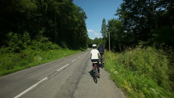 Thumbnail for Slow Motion - Retired Couple Cycling On Road In Village In France 4