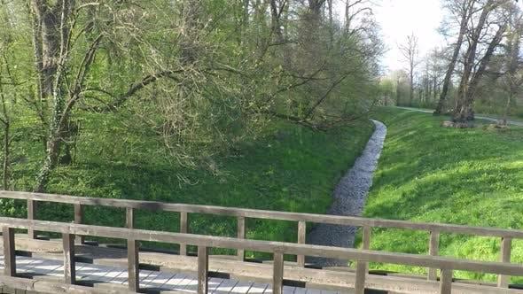 Thumbnail for Slow Motion Of Runner Crossing A Bridge In Park. 1
