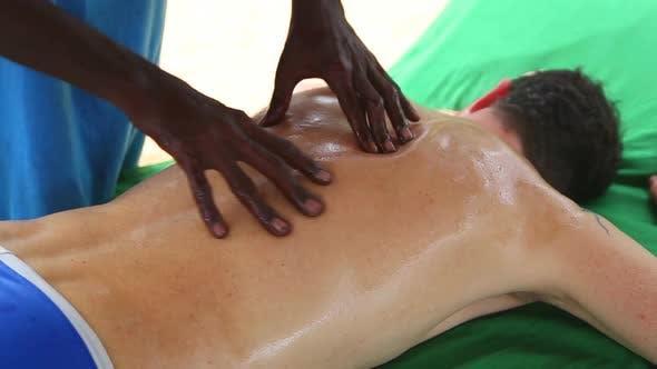 Thumbnail for Sri Lankan Man Giving Full Back Oil Massage To Caucasian Man 1