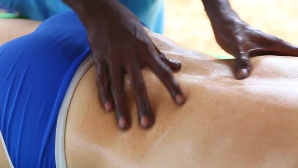 Thumbnail for Sri Lankan Man Giving Lower Back Oil Massage To Caucasian Man 2