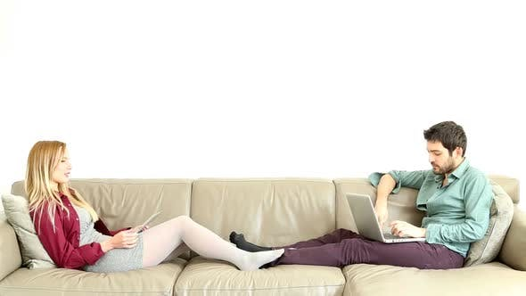 Thumbnail for Woman Leaning On Couch Speaking To Sitting Young Man 1