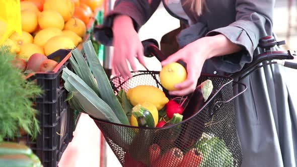 Thumbnail for Close Up Of A Bike With Basket, Full Of Fruit And Vegetables
