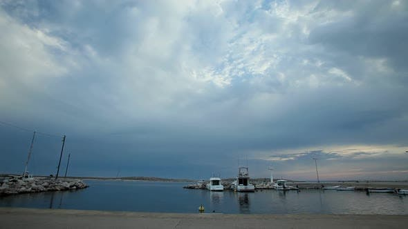 Thumbnail for Timelapse Of Clouds Passing Over Harbour On Croatian Island.