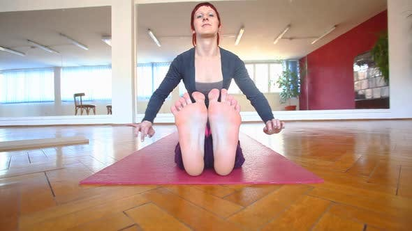 Thumbnail for Women Stretching Over Her Feet In Yoga Asana