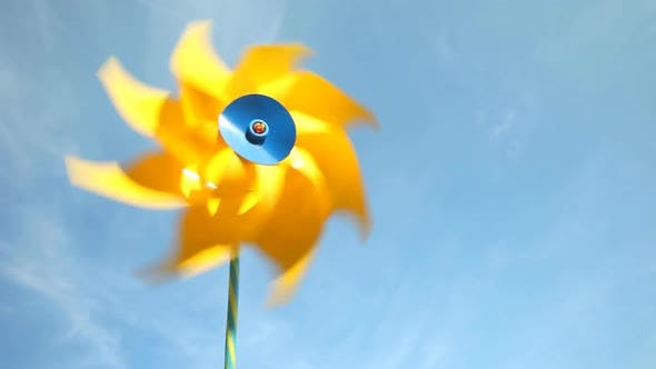 Thumbnail for Yellow windmill spinning in wind on blue sky 14