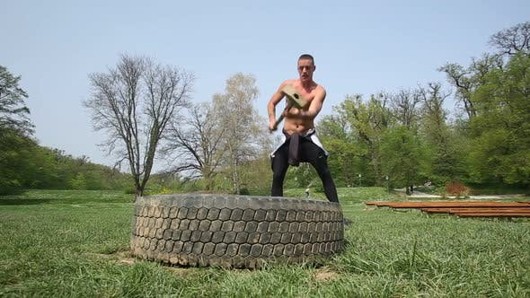 Thumbnail for Muscular Man Hitting Tire With A Hammer 1