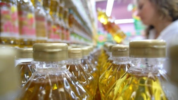 Thumbnail for Housewife Woman Choosing Sunflower Oil In