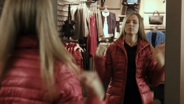 Thumbnail for The Girl Tries On a Red Jacket
