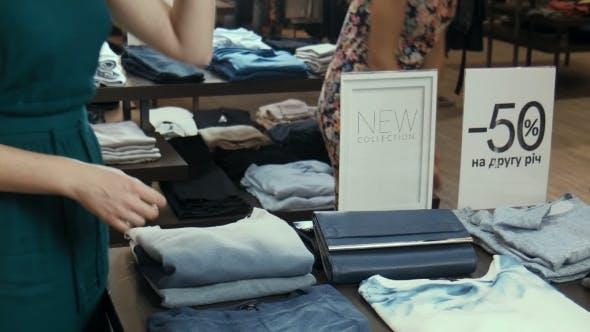 Thumbnail for The Girl At The Counter Selects a Handbag