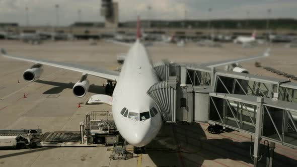 Thumbnail for Commercial Airline Airplane at Busy Airport Terminal