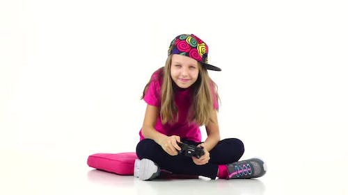 Teen with Console Playing Video Game, White Background. Slow Motion