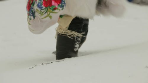 Woman Walks Through Deep Snow