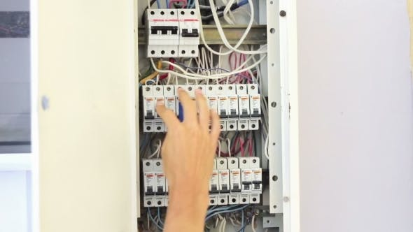 Cover Image for Switching Electric Breaker Box.