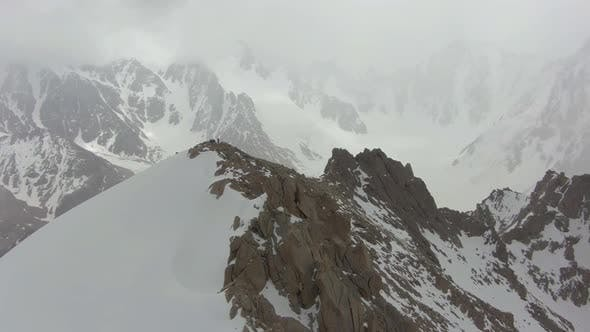 Cover Image for Mountaineers on Top of Mountain. Tian Shan, Kyrgyzstan. Aerial View