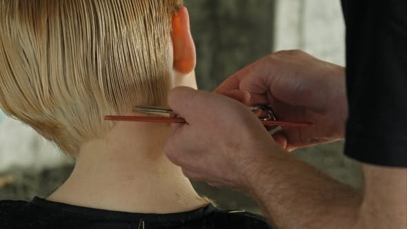 Thumbnail for Hairdresser Trimming Blond Hair With Scissors