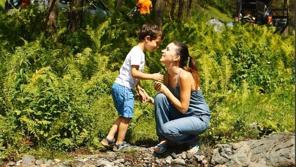 Thumbnail for Mother With Her Son Are Sitting Near A Stream