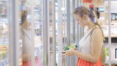 Young Woman At The Supermarket