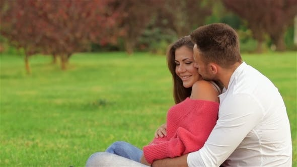 Thumbnail for Couple Sitting On The Grass