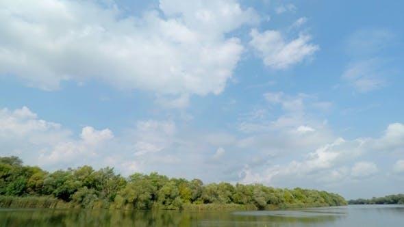 Thumbnail for Wolken über dem Fluss