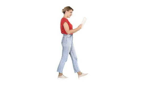 Cover Image for Happy woman walking with tablet on white background.