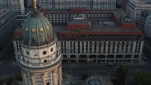 AERIAL: Berlin Gendarmenmarkt German Church Tower Close Up at Dusk