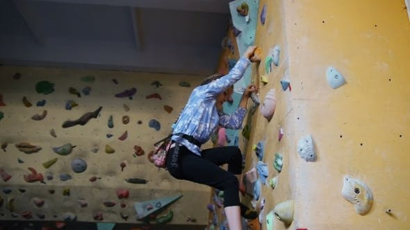 Thumbnail for Little Girl Climbing On Artificial Boulders In Gym