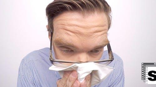 Businessman Sneezing