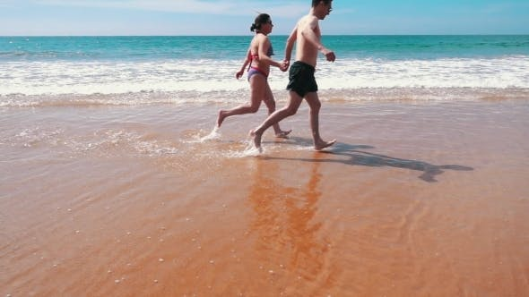 Thumbnail for Happy Couple Running On Beach
